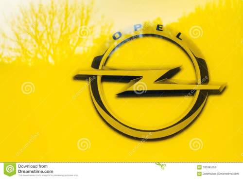 small resolution of opel company logo on car in front of dealership building
