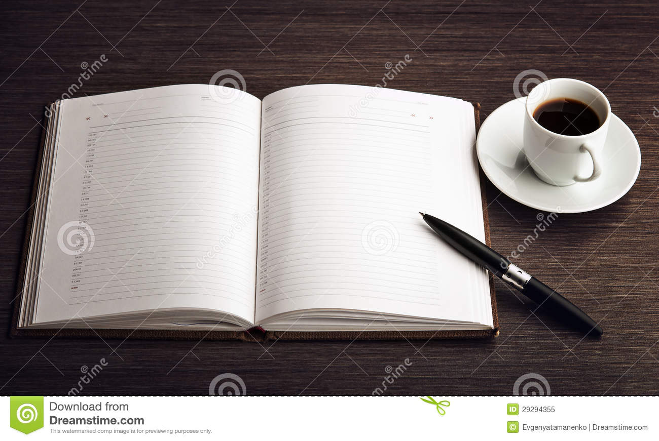 Open A Blank White Notebook Pen And Coffee On The Desk