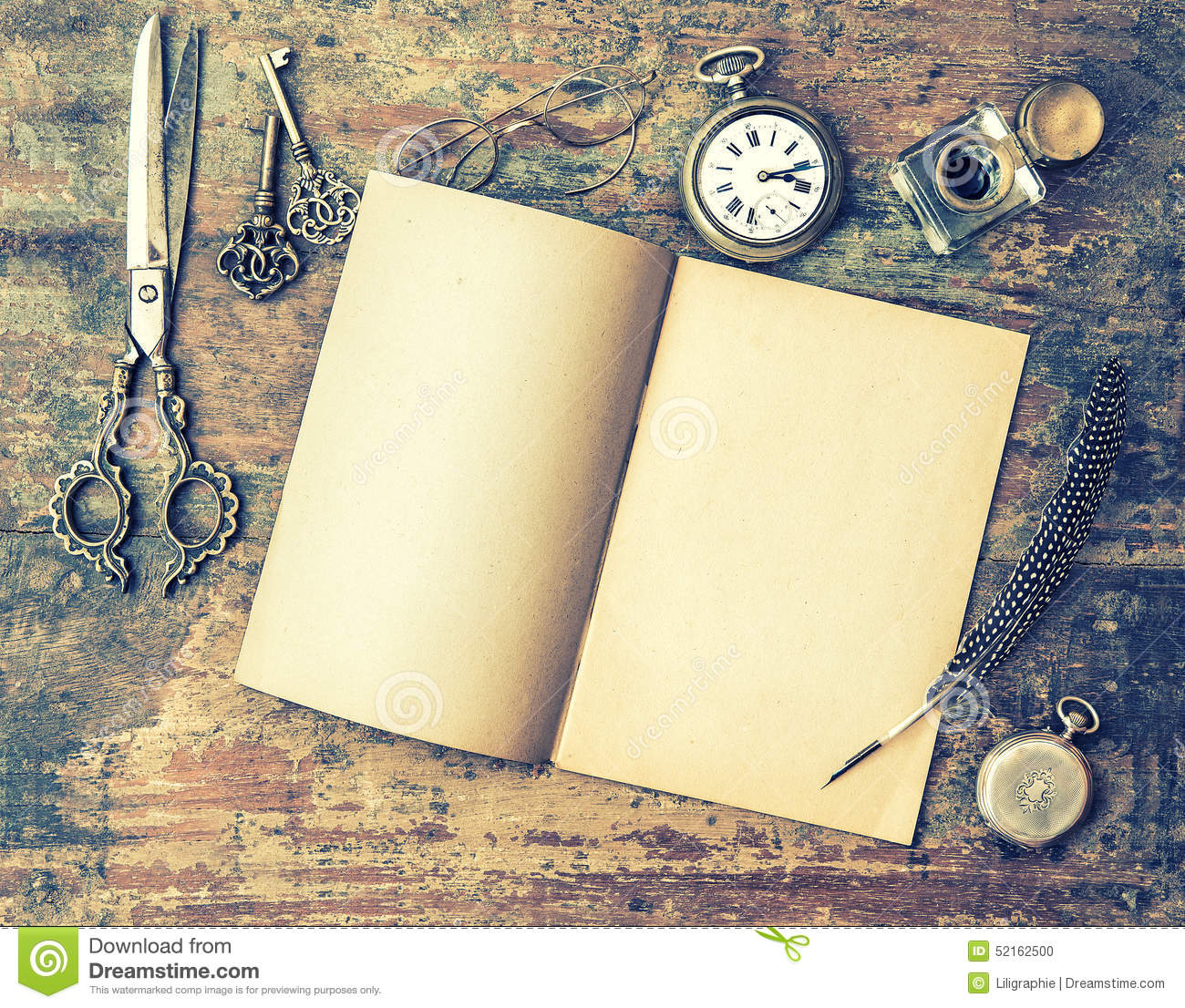 Open Book And Antique Writing Tools On Wooden Table