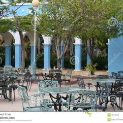 Iron Patio Chair Leather Nailhead Side Open Cafe At Resort Royalty Free Stock Image - Image: 4872676