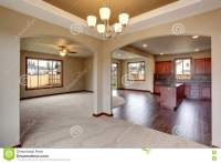 Open Floor Plan Interior With Carpet And Fireplace Stock