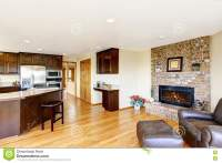 Open Floor Plan Kitchen And Living Room With Brick