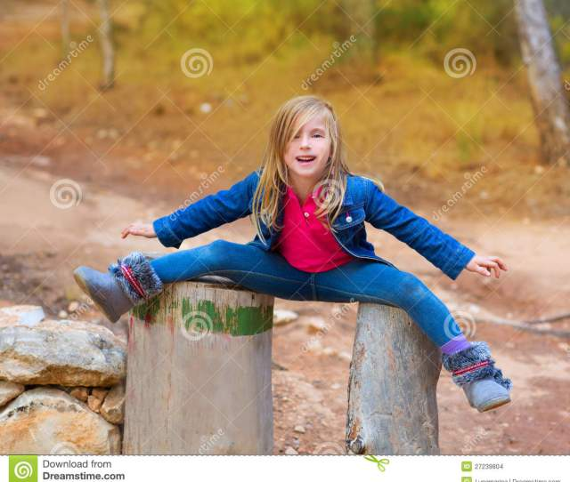 Open Legs Children Girl Or Tree Trunks At Forest