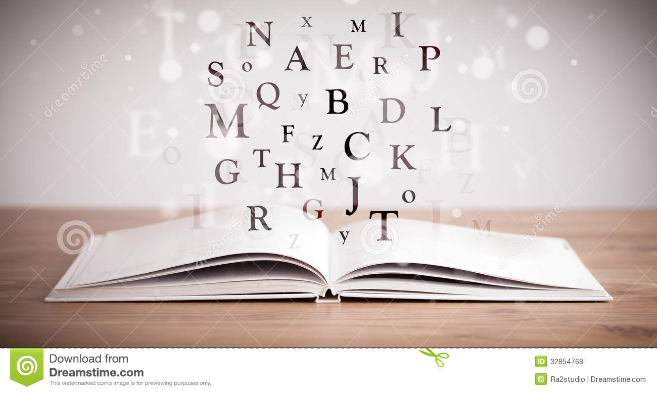 Opened Book With Flying Letters Royalty Free Stock Photos