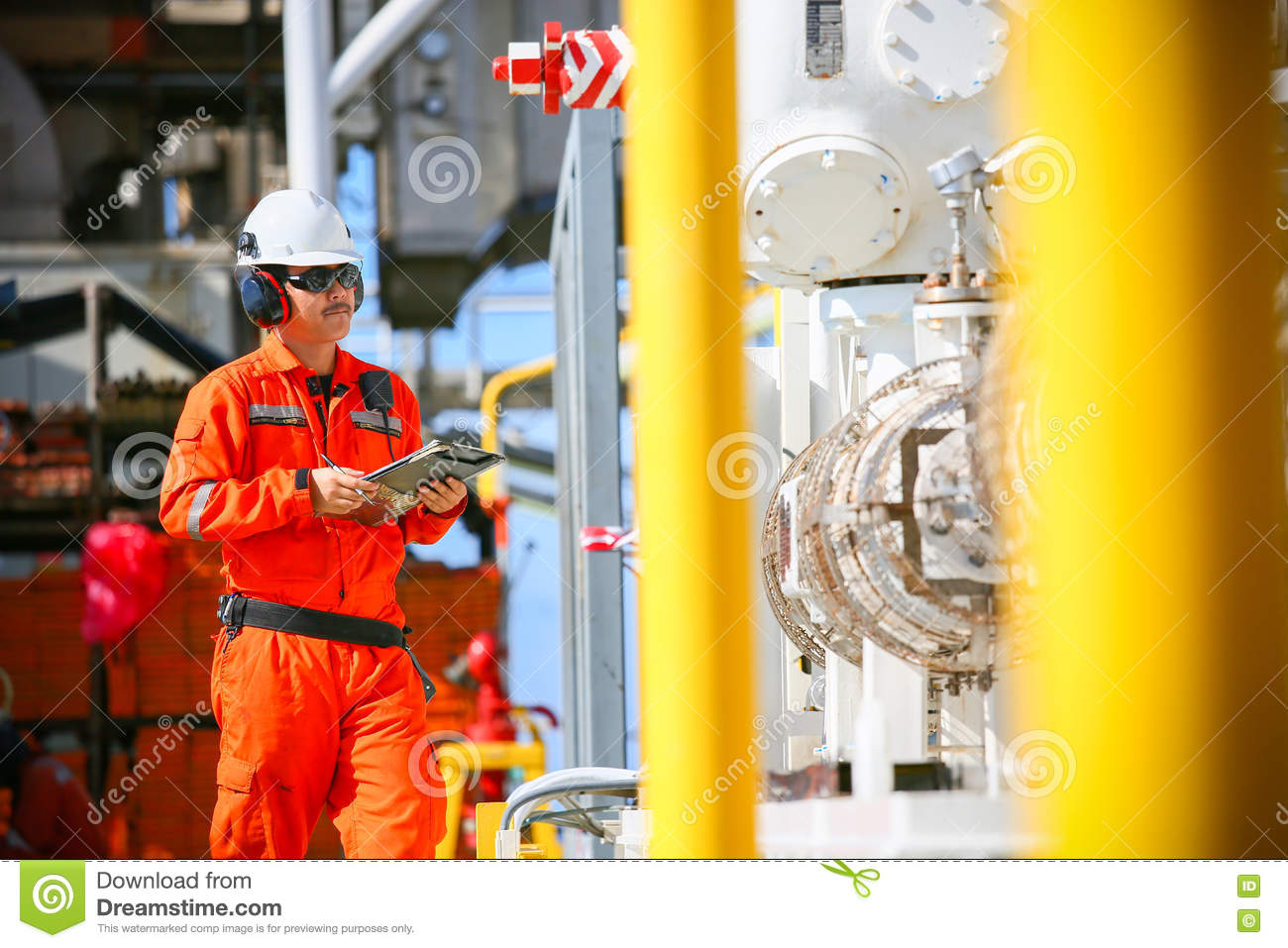 Operator Recording Operation Of Oil And Gas Process At Oil