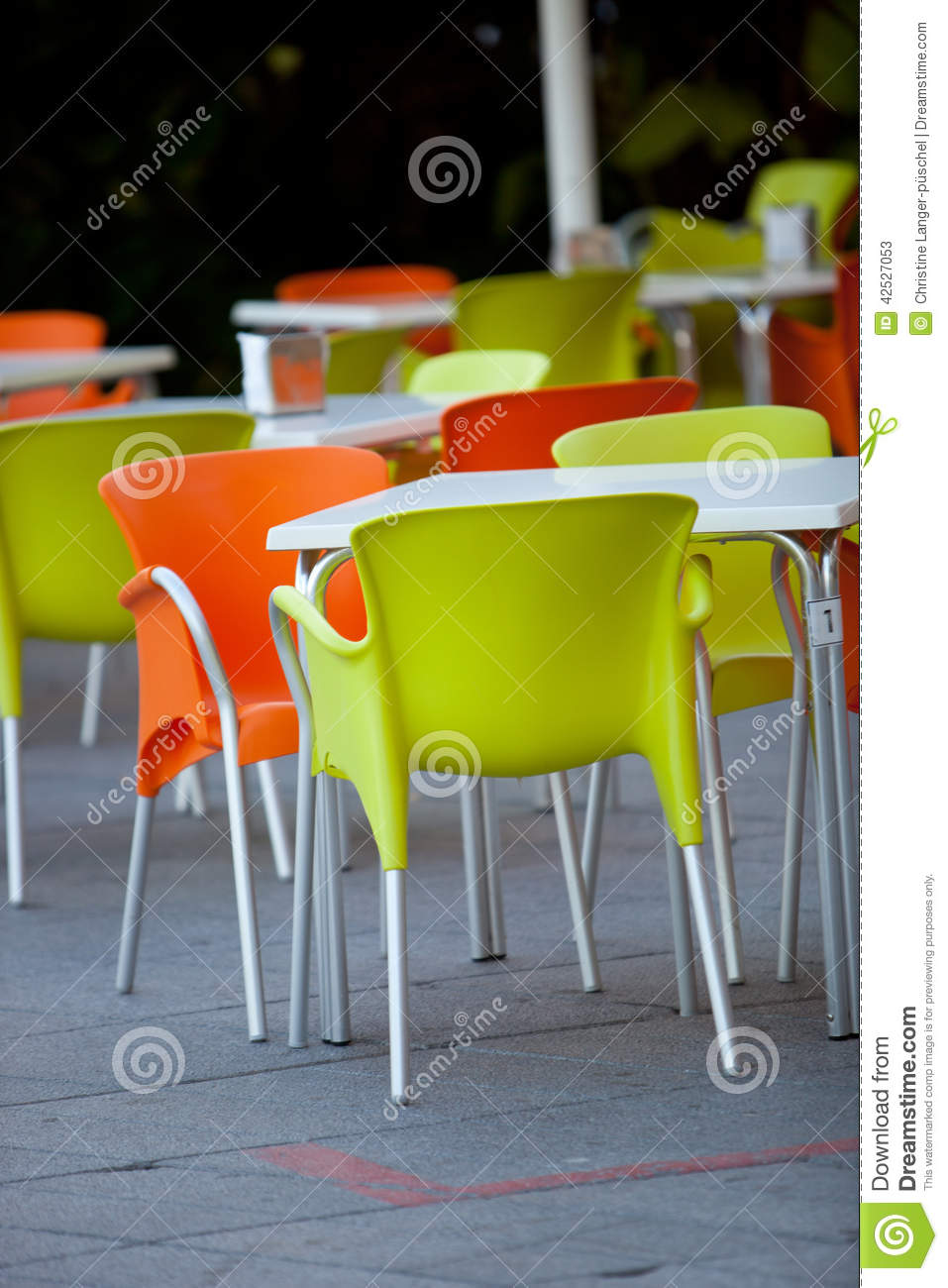 white plastic chairs gliding rocker chair outdoor furniture of a restaurant or cafeteria stock image - image: 42527053