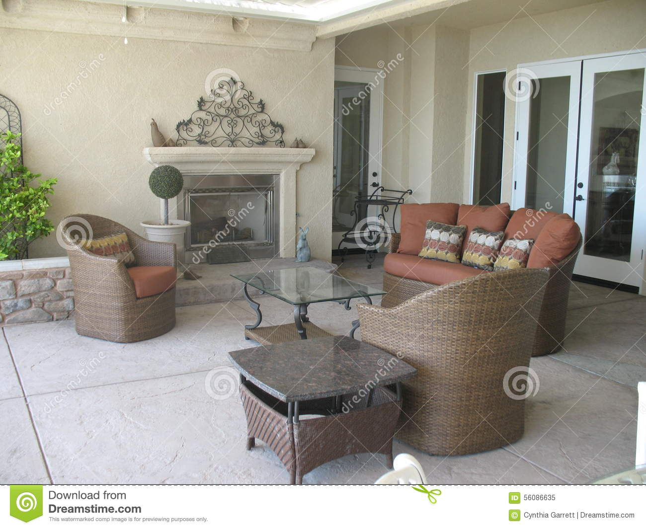 outdoor patio with fireplace and wicker furniture stock image image of table friends 56086635