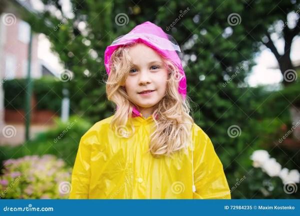 Outdoor Of Little Blonde Girl In Yellow Raincoat
