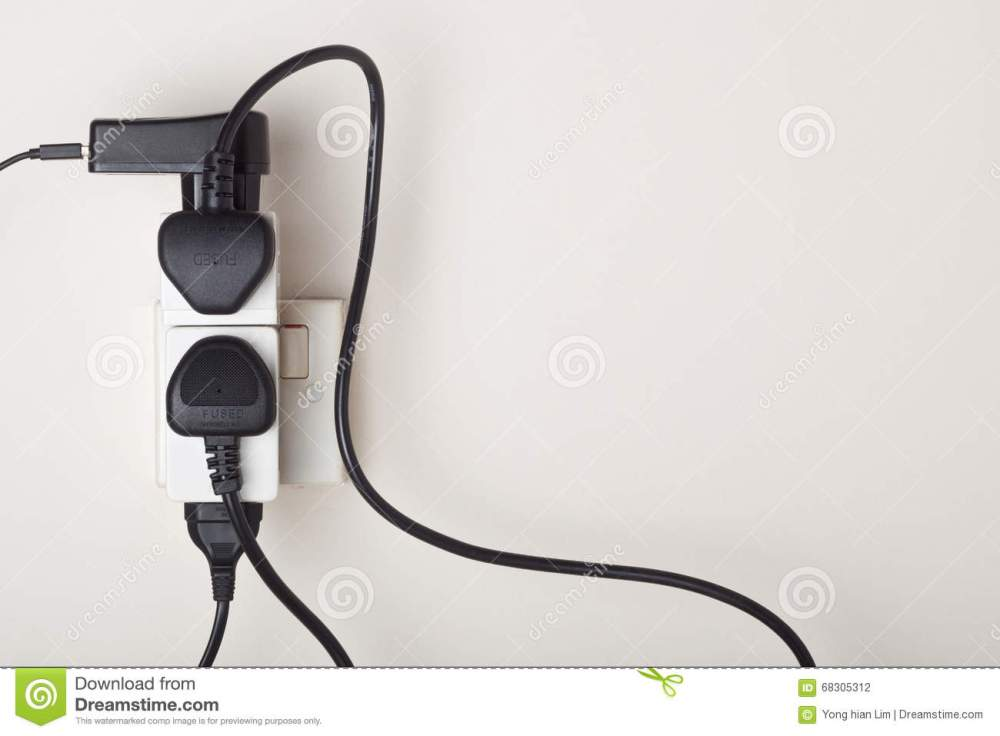 medium resolution of many power cables plug into an ac power outlet on a wall