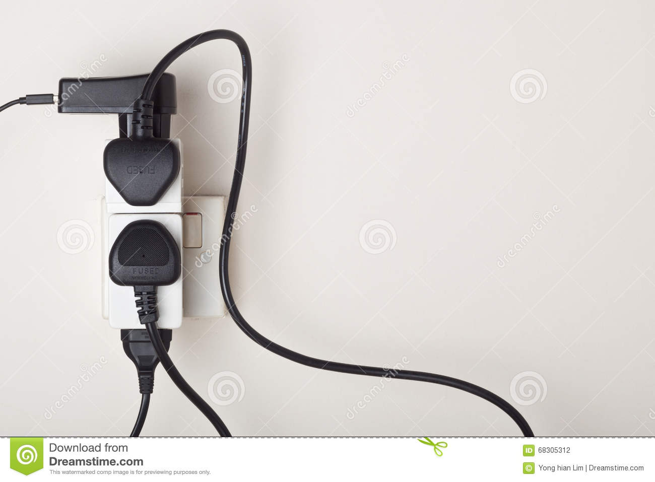 hight resolution of many power cables plug into an ac power outlet on a wall