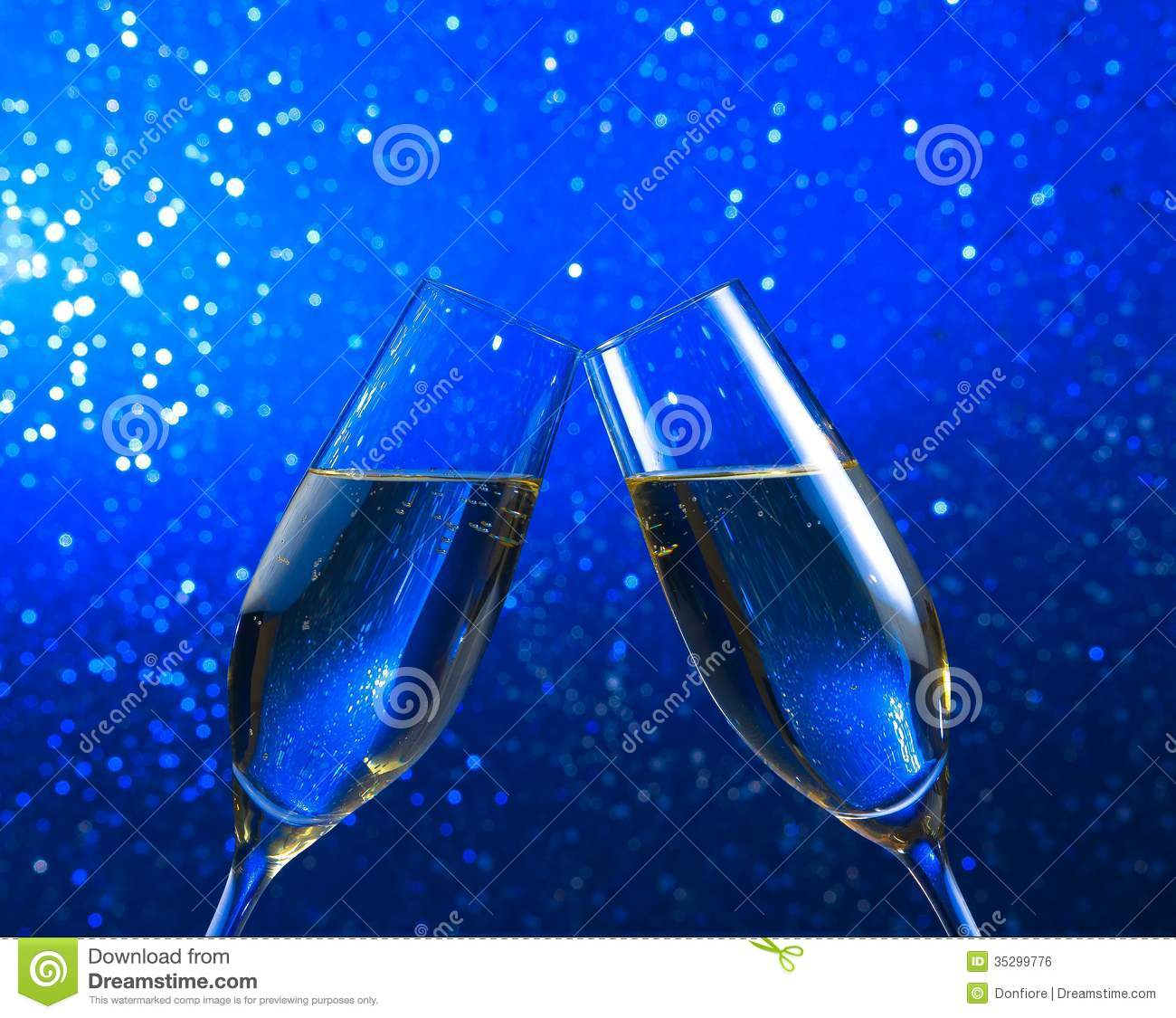 A Pair Of Champagne Flutes On Blue Light Bokeh Background