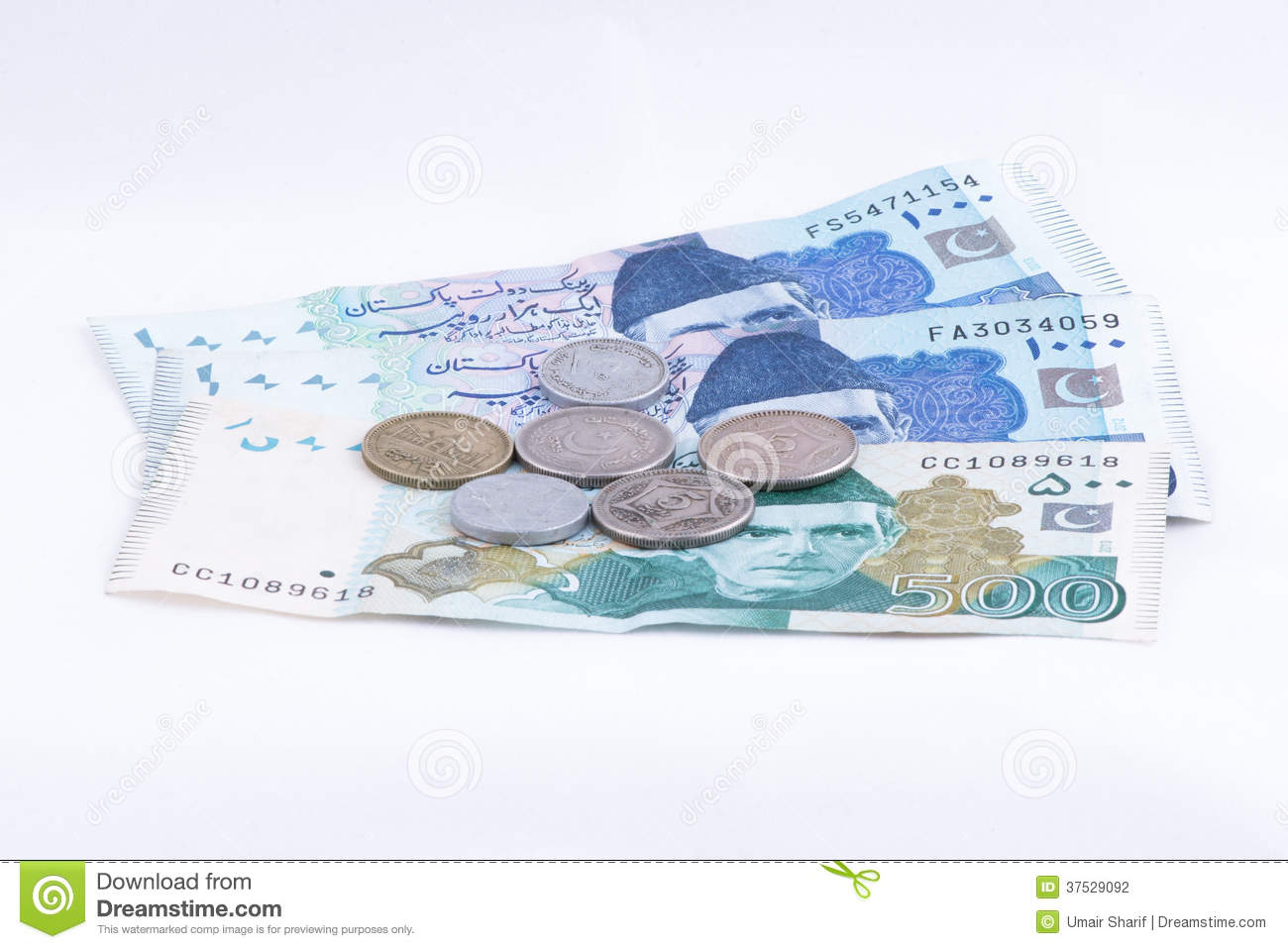 Pakistan Currency Notes And Coins Stock Photo