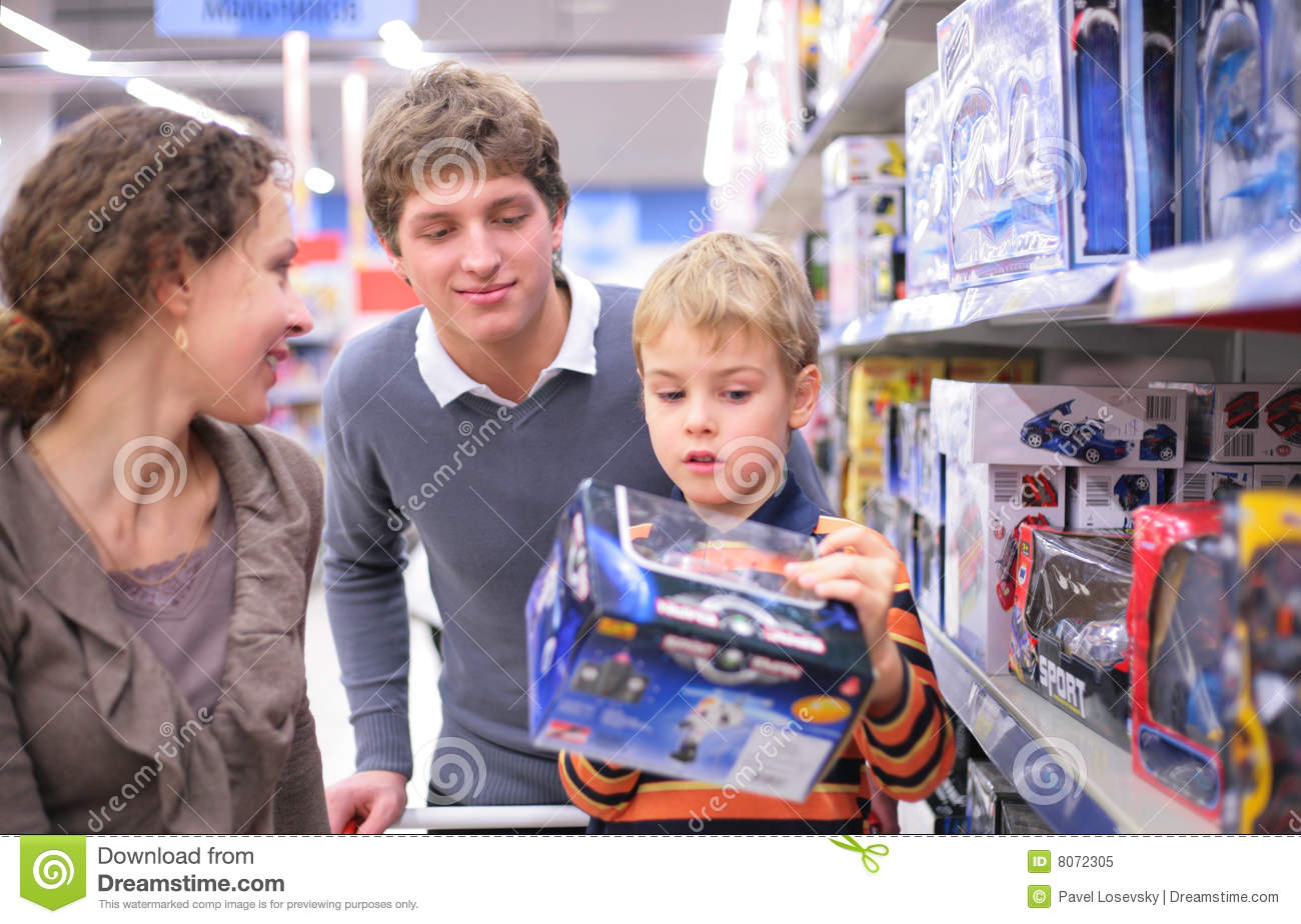 Parents With Son With Toy In Shop Stock Image - Image of interior. game: 8072305