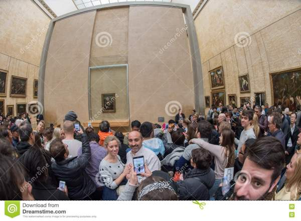 Paris France - April 30 2016 Mona Lisa Painting Louvre Hall Crowded Of Tourist Editorial