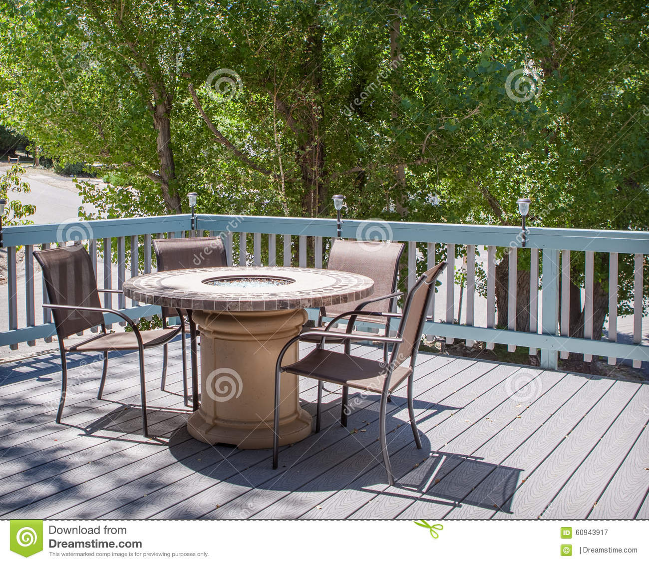 Chairs Around Fire Pit Patio Table With Fire Pit And Chairs On Deck Stock Photo