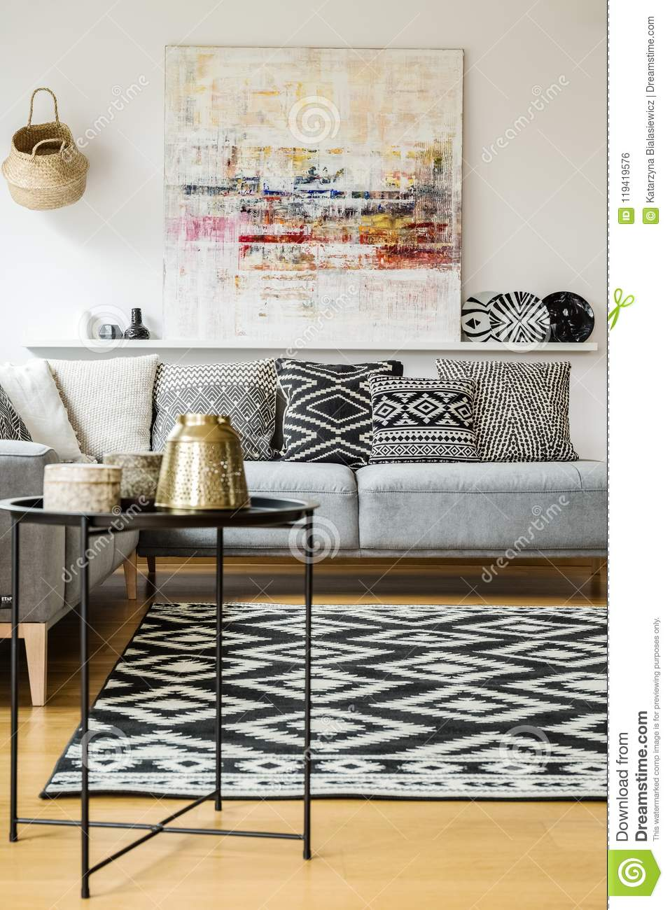 grey sofa living room carpet white cupboard patterned and cushions on in modern