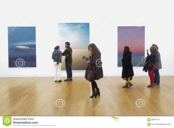 People Looking at Art Gallery