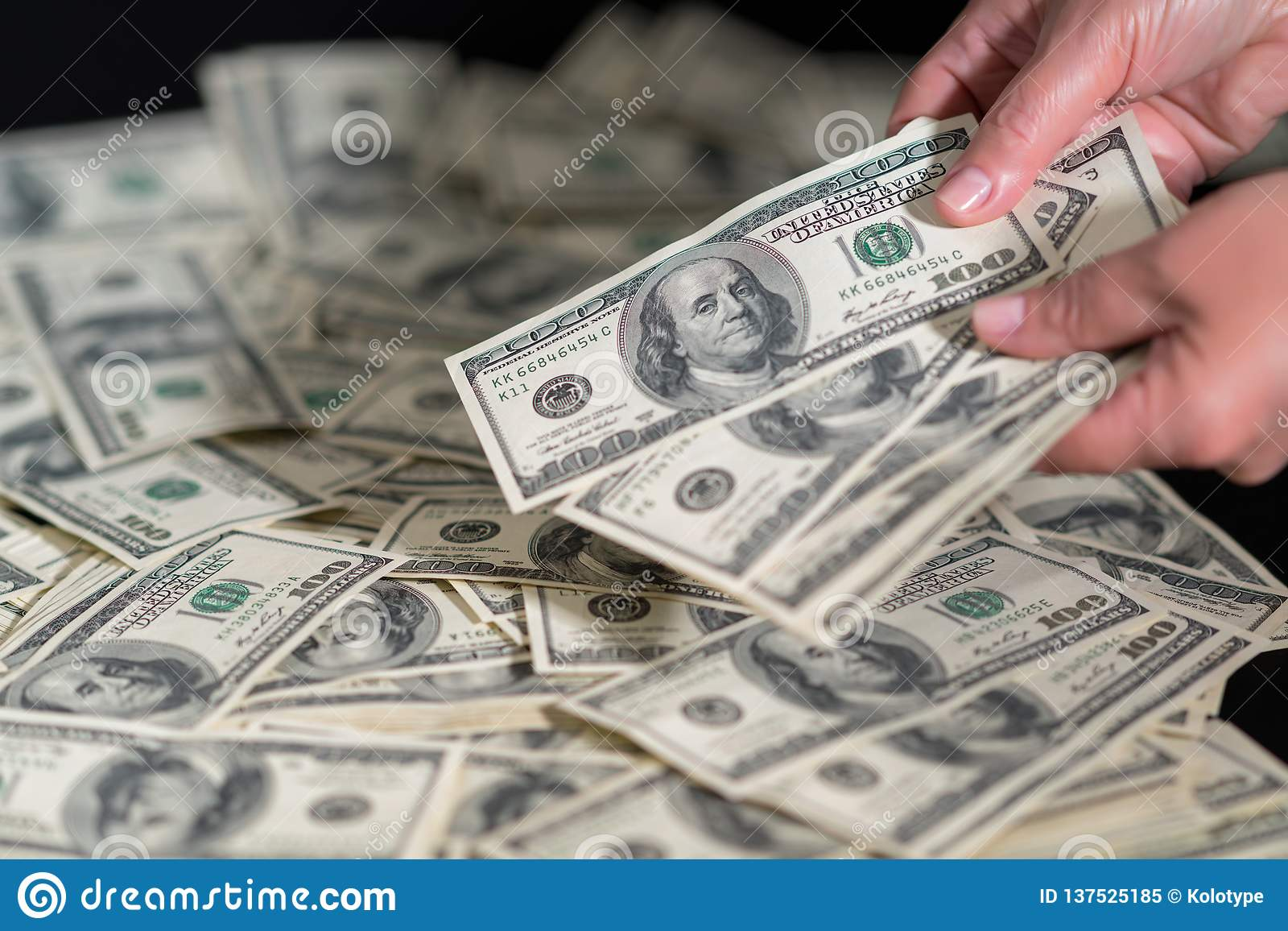 Person Counting 100 Dollar Bills Onto A Pile Stock Image
