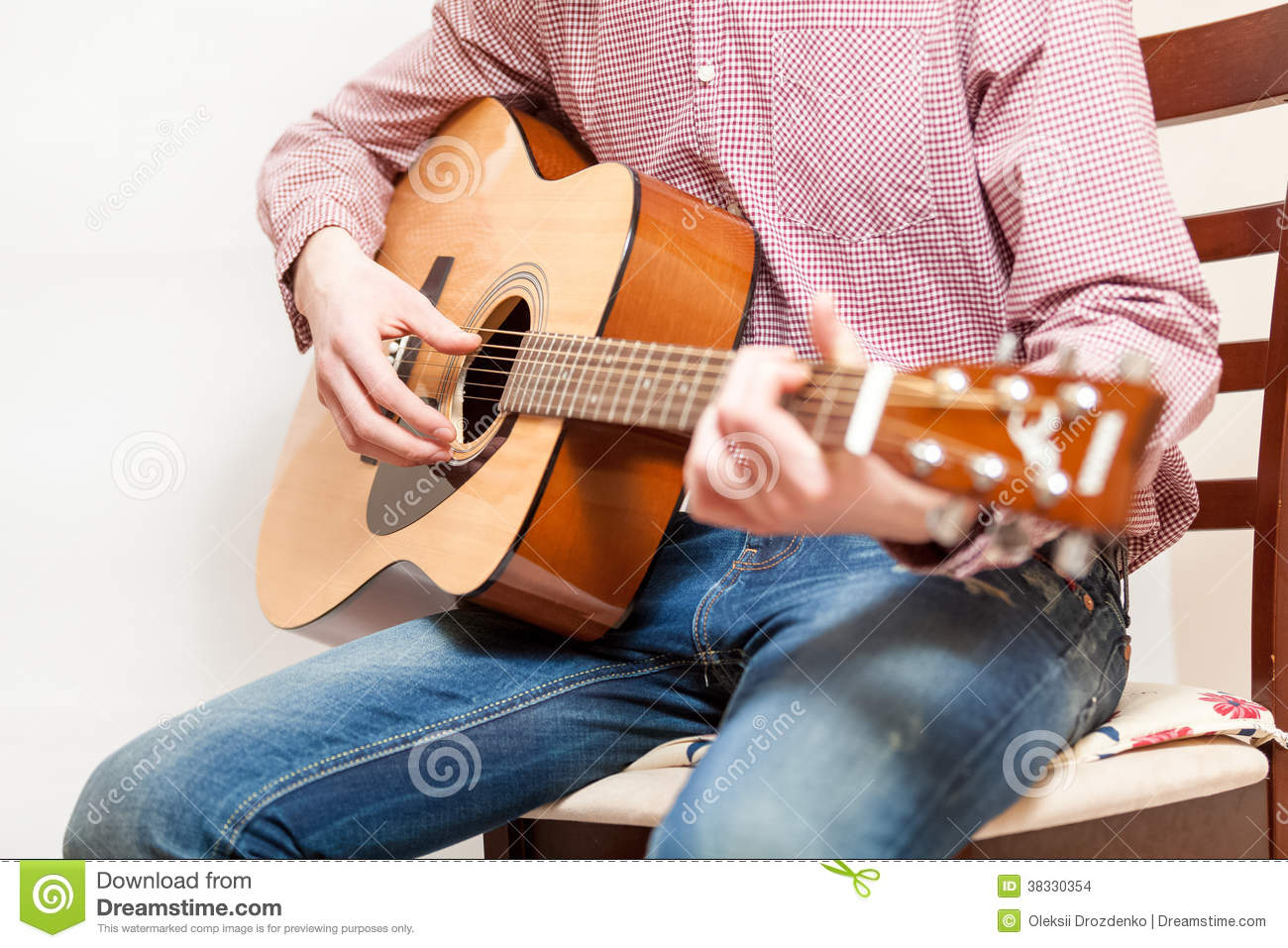 best chair for guitar playing circular lounge photo of man sitting on and acoustic