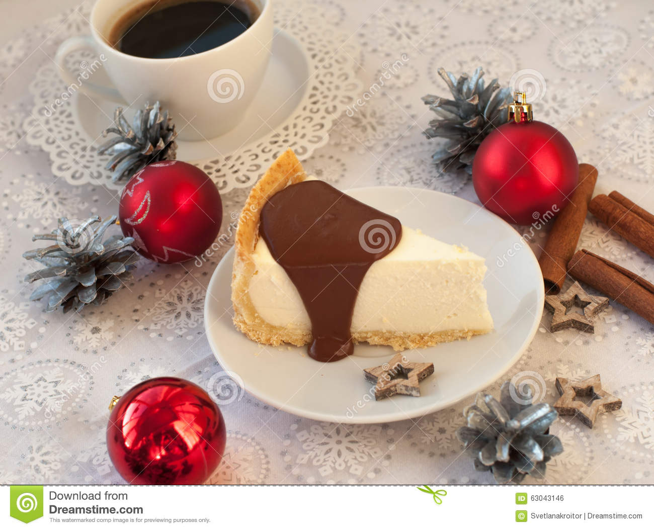 A A Piece Of An Appetizing Cheese Cake With Melted Chocolate On It. A Cup Of Coffee. Silver Cones. Cinnamon Sticks And Christmas-t Stock Photo ...