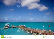Pier And Boat In Ocean Royalty Free Stock