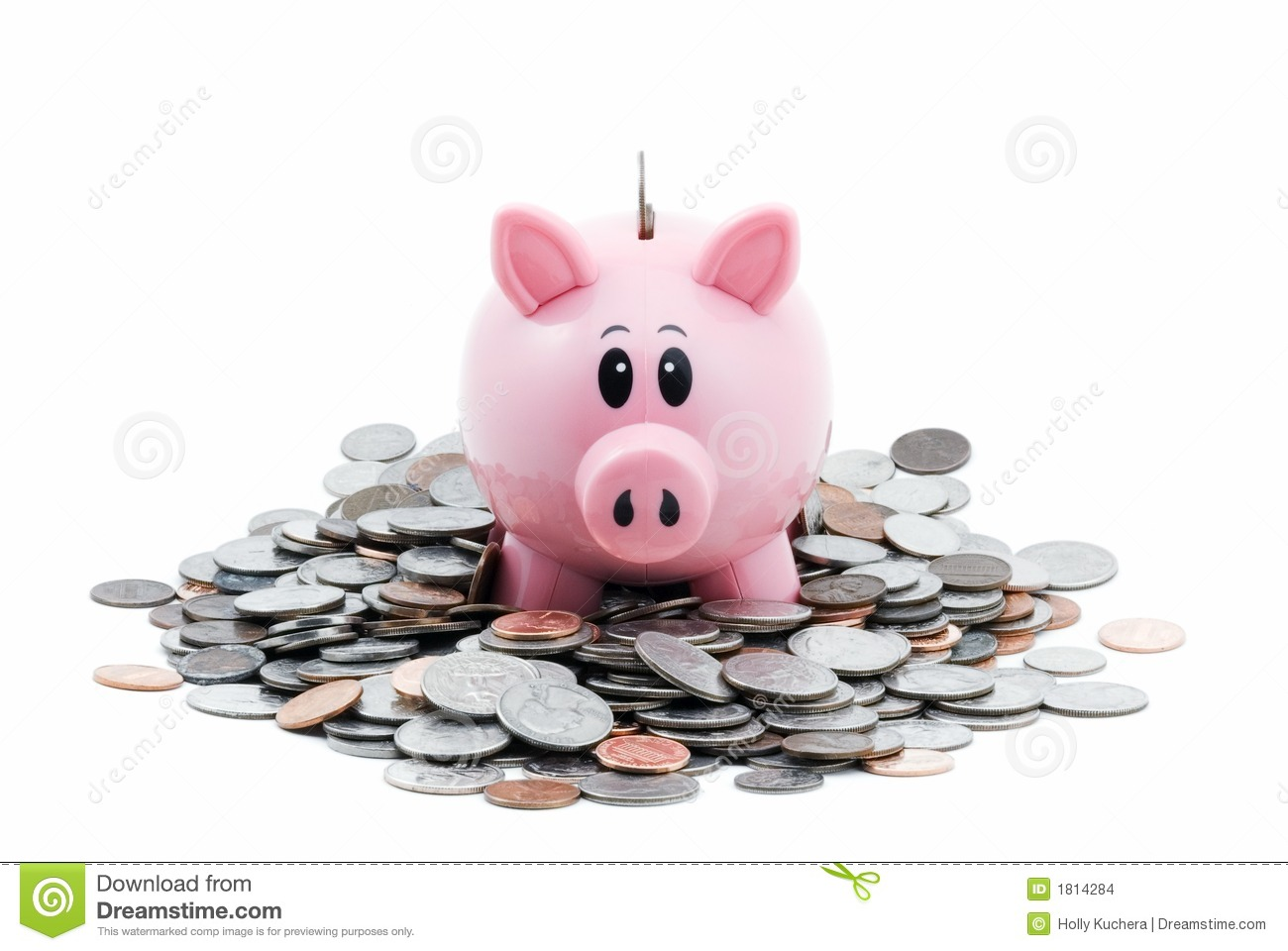 Piggy Bank In Pile Of Coins Stock Photo