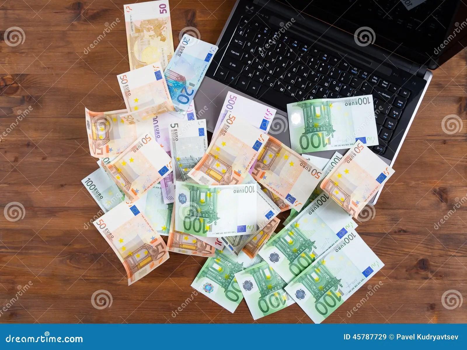 Pile Of Euro Money With Laptop Stock Photo