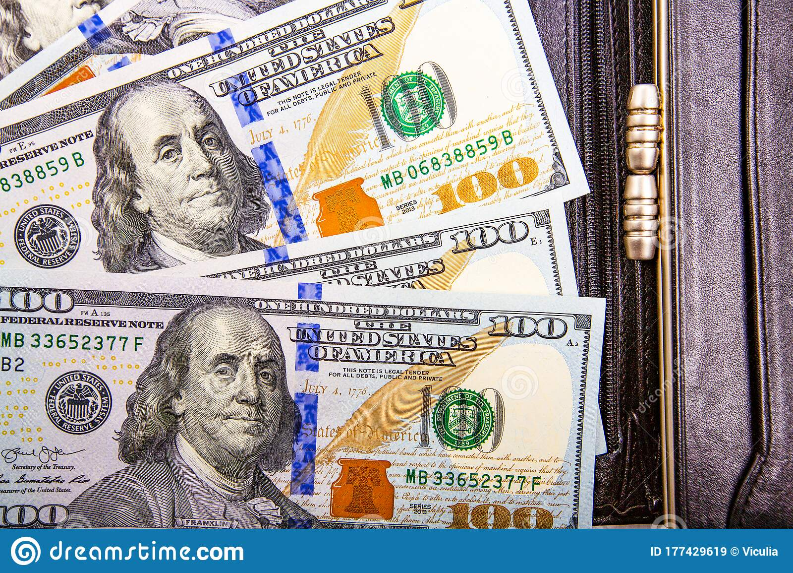 A Pile Of Us Banknotes With President Portraits Cash Of