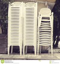 Pile Of White Plastic Chairs Stock Photo - Image: 46632764