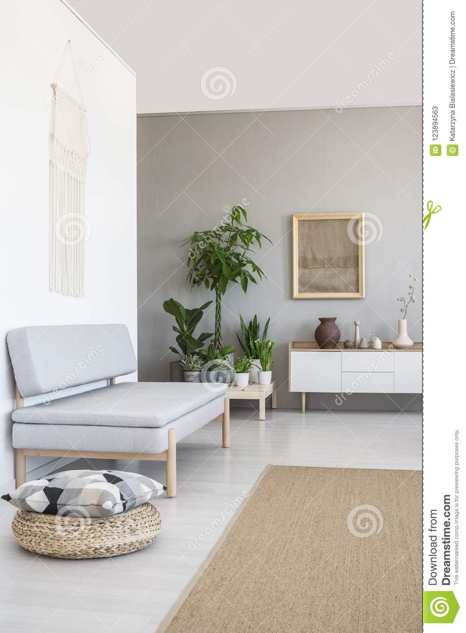 living room pouf furniture couches pillow on next to grey couch in scandi interior