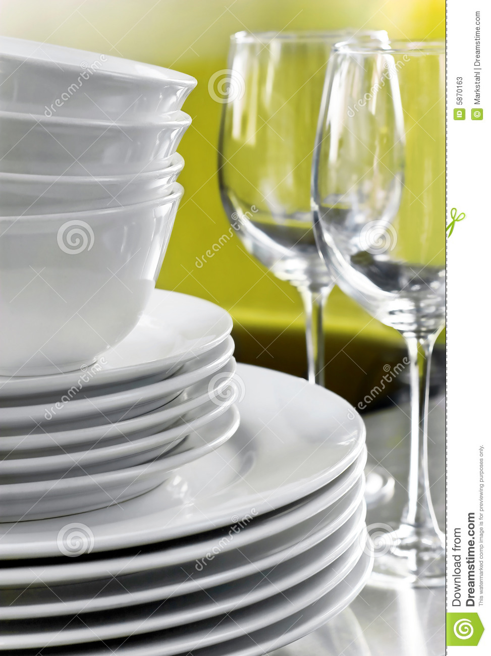 Plain White Plates Bowls And Crystal Wine Glasses Stock