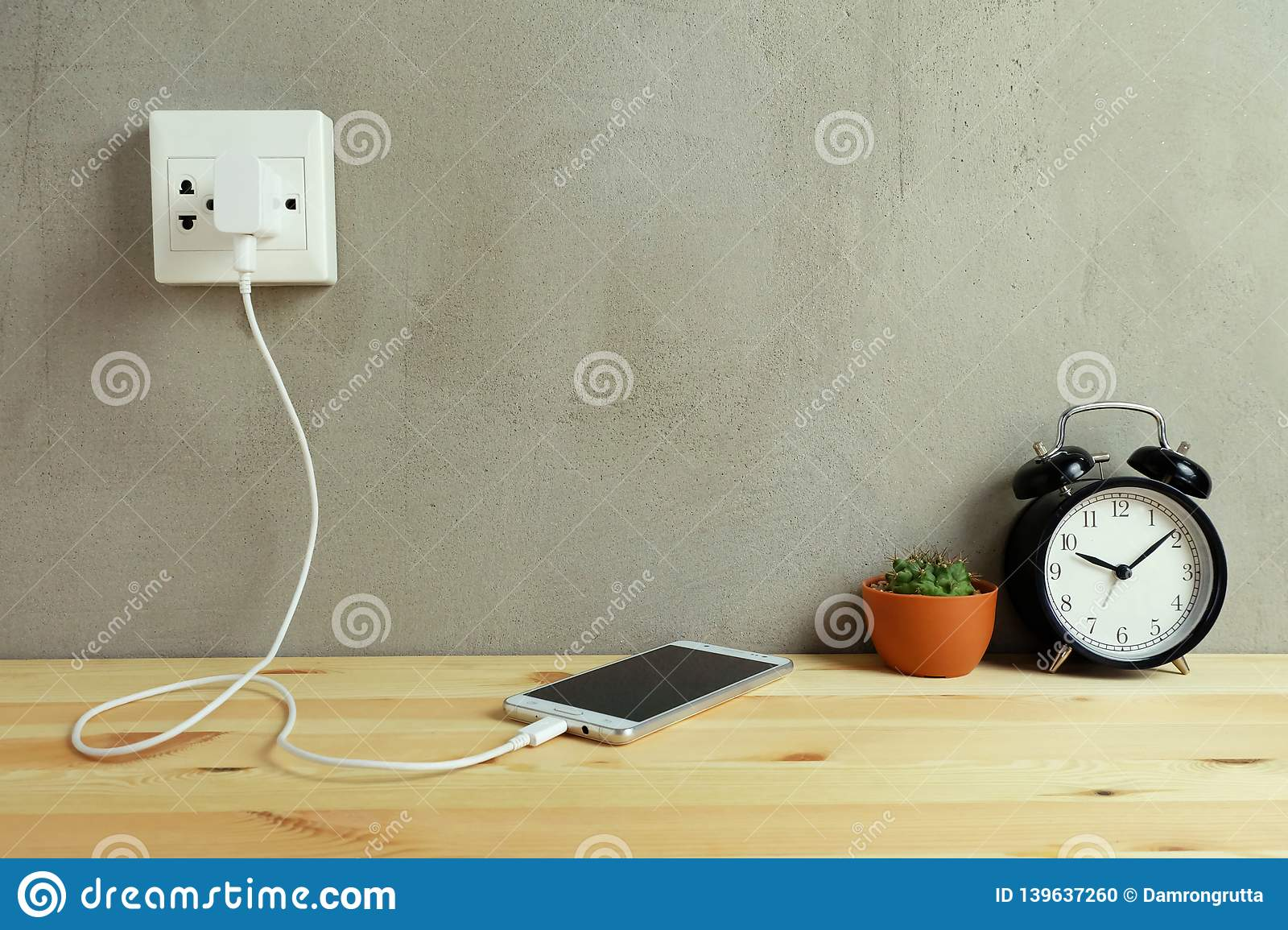 hight resolution of plug in power outlet adapter cord charger of mobile phone on wooden