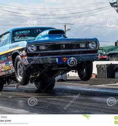 napierville september 13 2014 front side view vintage plymouth duster making a wheelie on the track during drag event  [ 1300 x 957 Pixel ]
