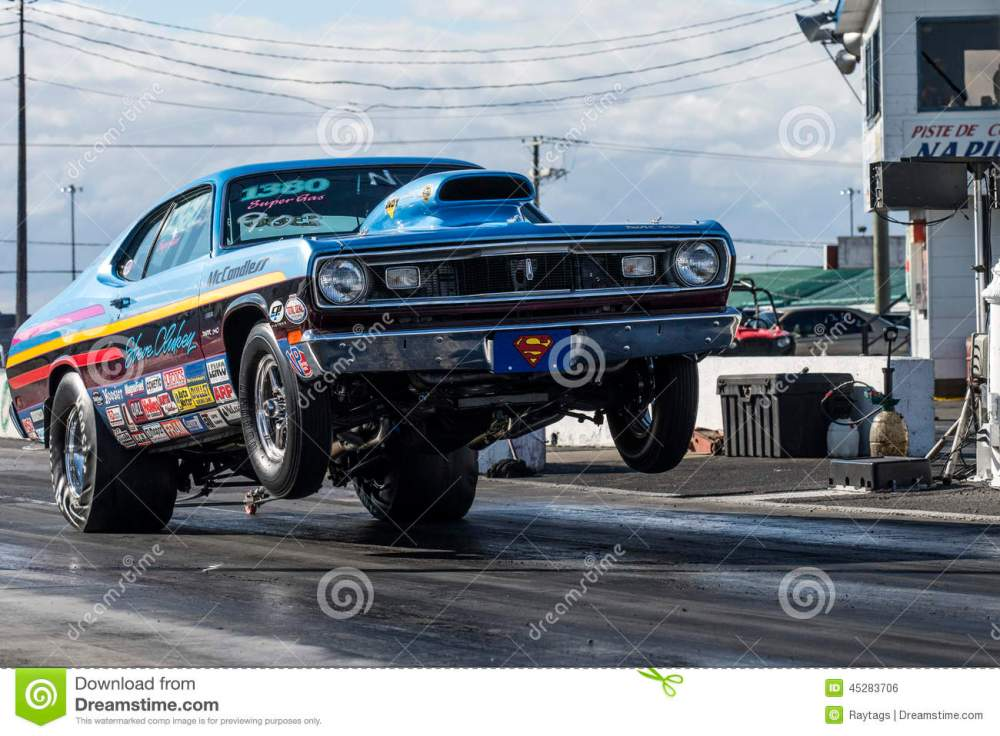 medium resolution of napierville september 13 2014 front side view vintage plymouth duster making a wheelie on the track during drag event