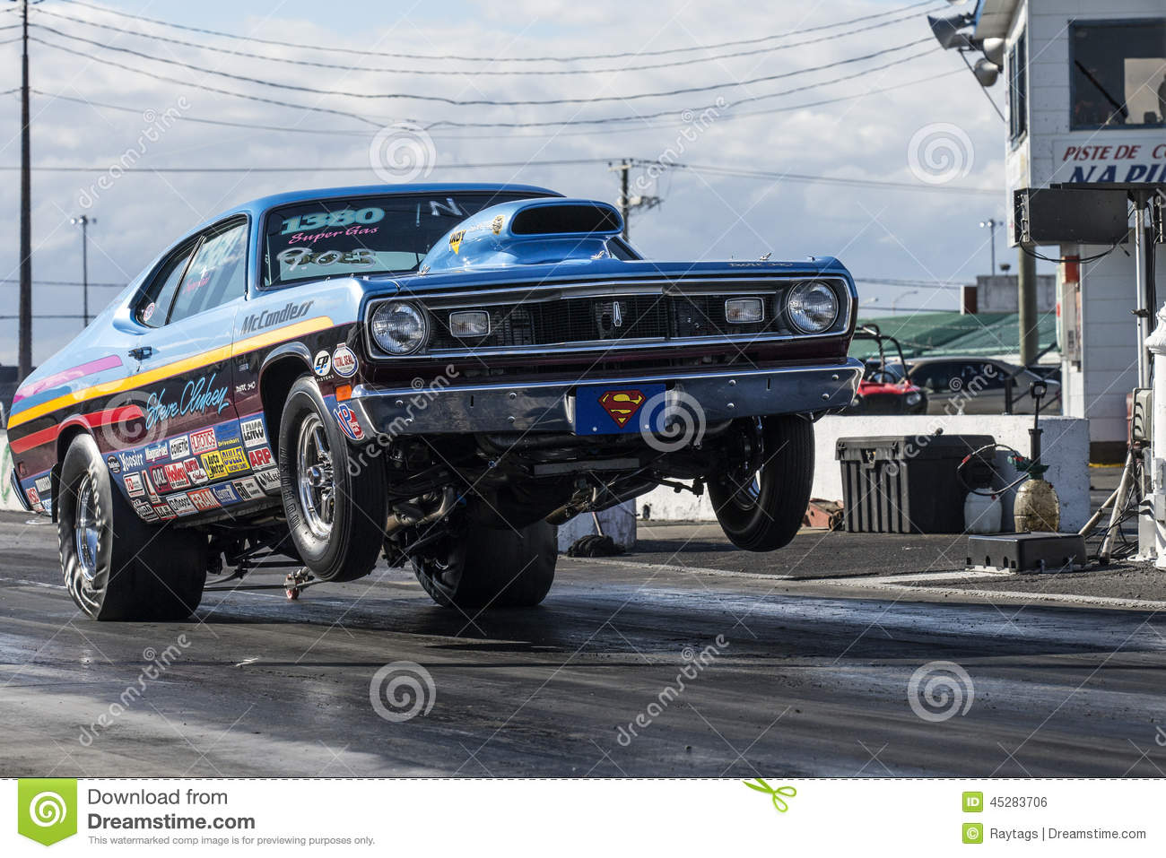 hight resolution of napierville september 13 2014 front side view vintage plymouth duster making a wheelie on the track during drag event