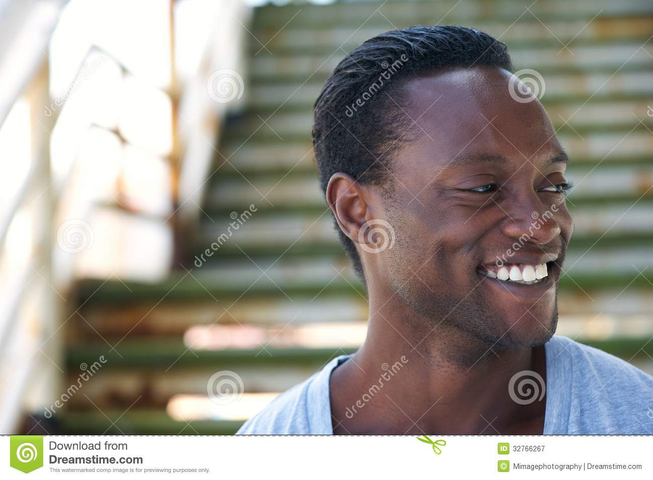 Portrait Of A Black Man Laughing And Looking Away Royalty