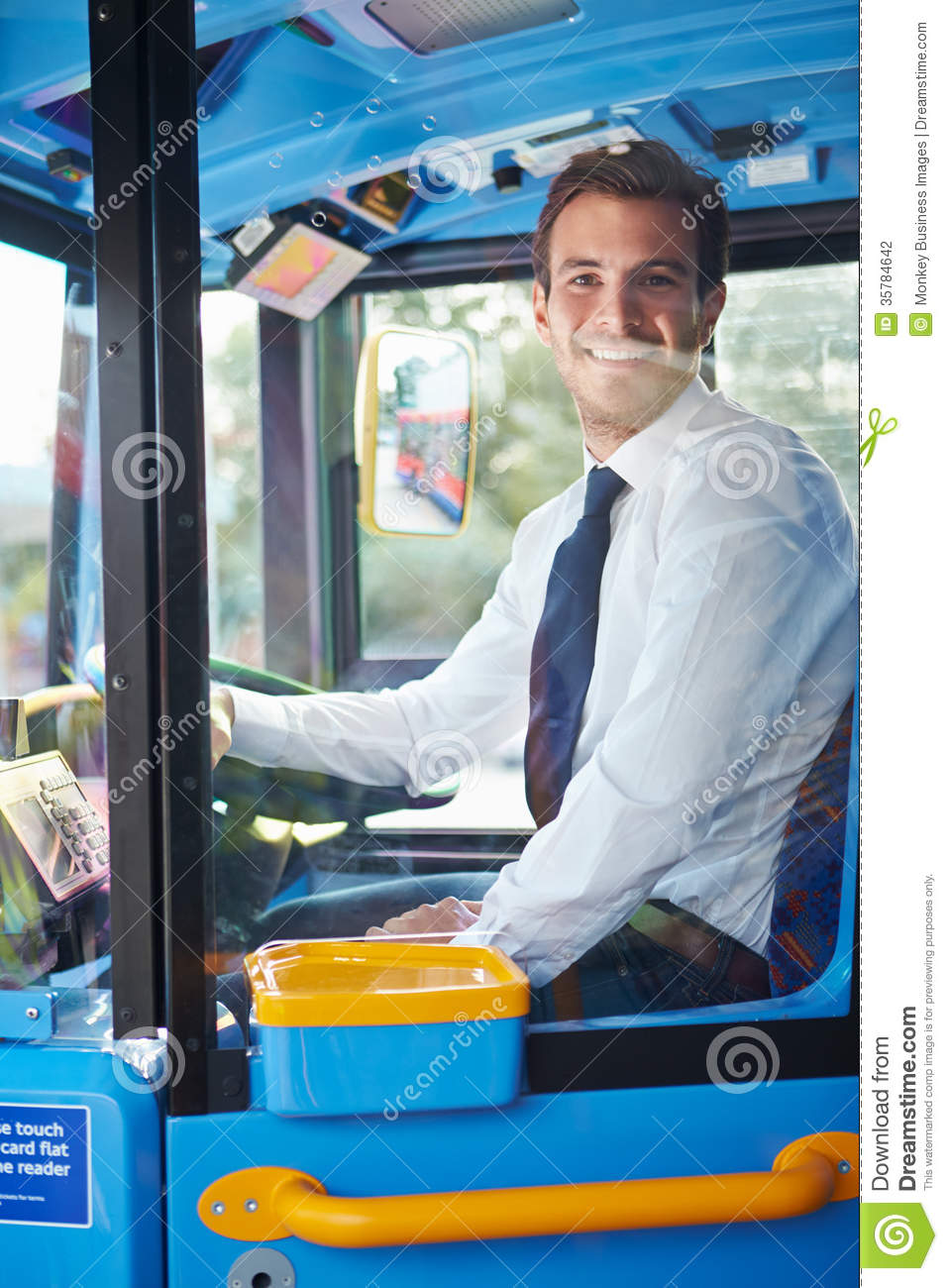 Portrait Of Bus Driver Behind Wheel Stock Photography