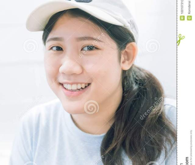 Portrait Of Cute Innocent Asian Teen Women Smile
