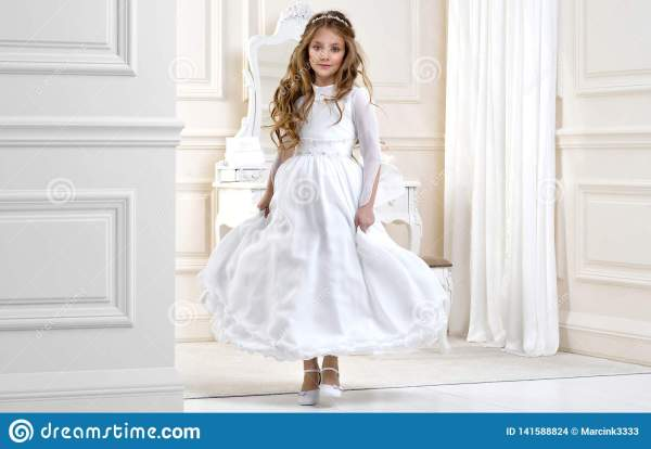 Portrait Of Cute Little Girl White Dress And Wreath