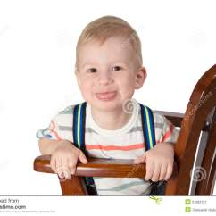 Little Boy Chairs For Office Portrait Of Sitting On A Chair Stock Photo