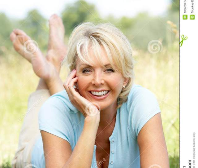 Portrait Of Mature Woman Relaxing In Countryside