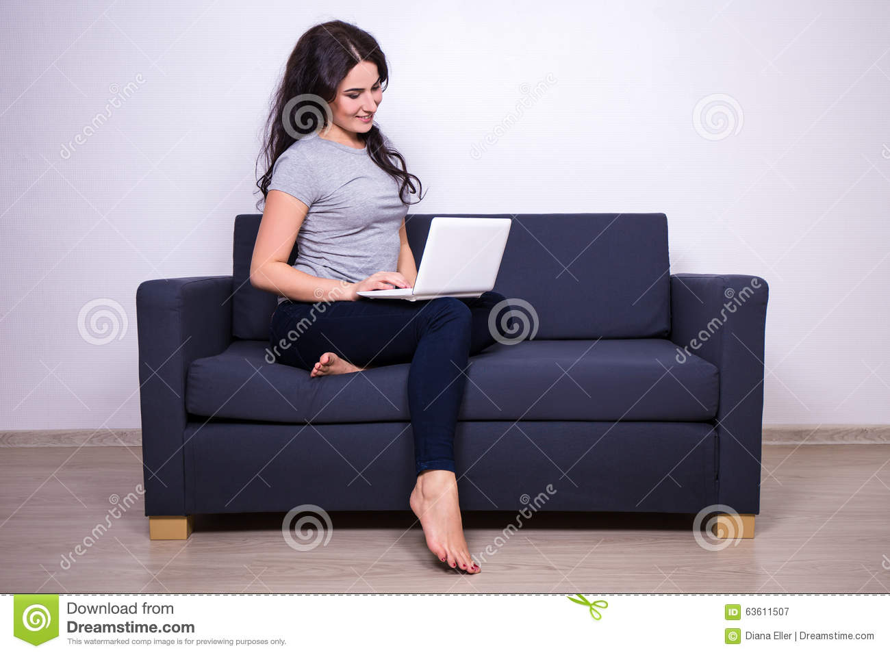 sitting pretty sofas lime green portrait of woman on sofa and using