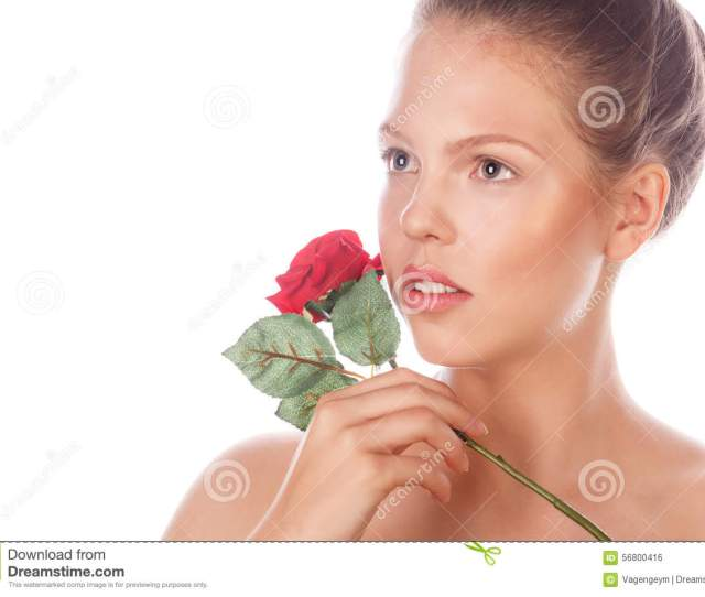 Portrait Of A Teen Girl With A Rose