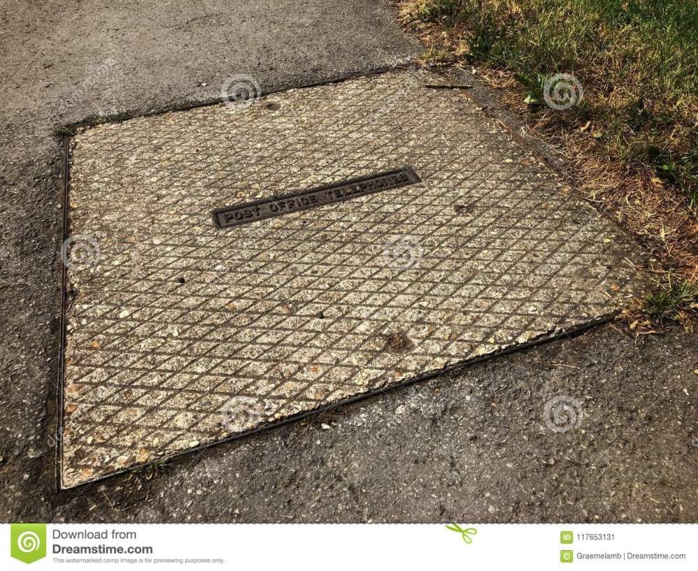 medium resolution of square post office manhole cover leading to underground telephone cables