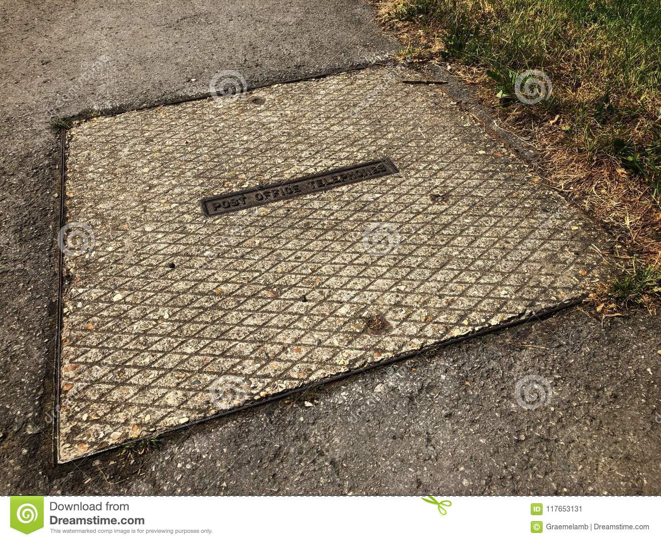 hight resolution of square post office manhole cover leading to underground telephone cables