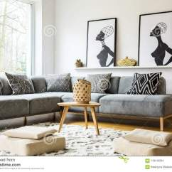 African Living Room Decor Idea Poufs On Carpet In Bright Interior With Grey