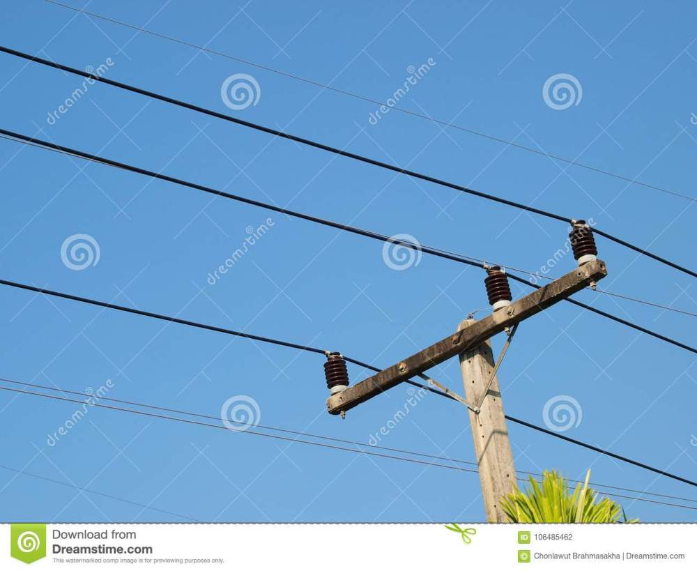 medium resolution of three phase power electricity lines installed on top of concrete pole with ceramic isolators blue sky background