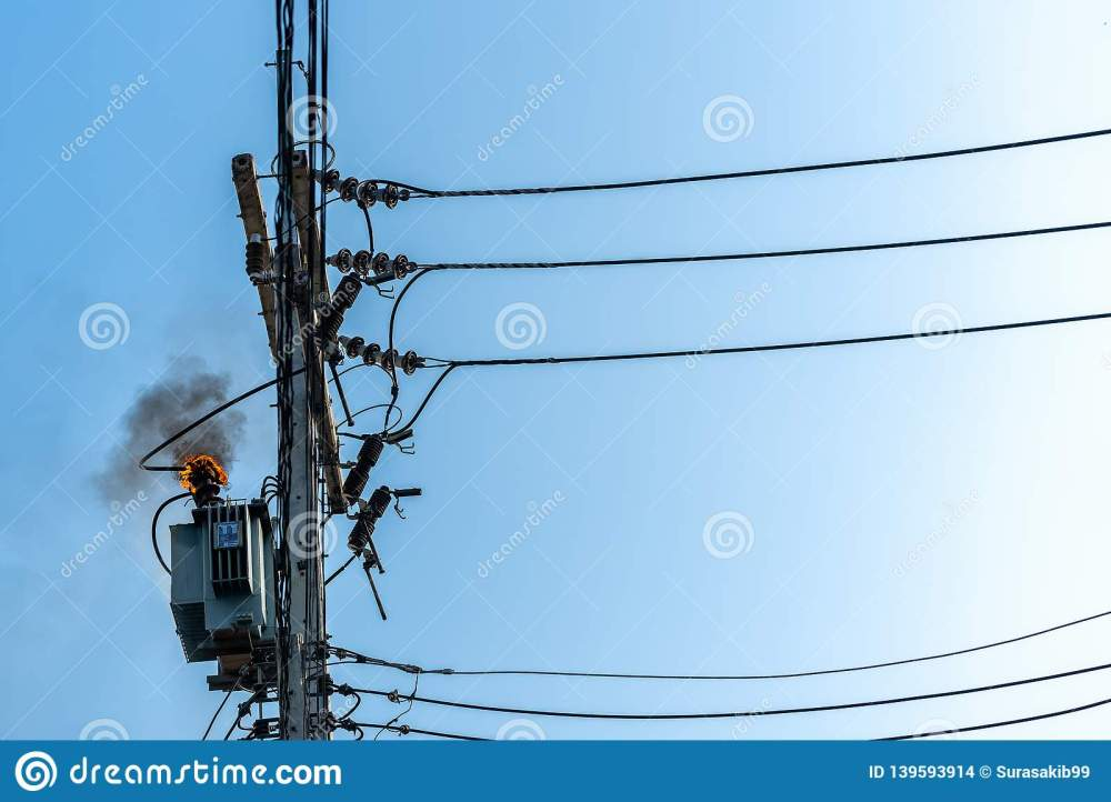 medium resolution of power pylon overload or electric short circuit at transformer on poles and fire or flame with