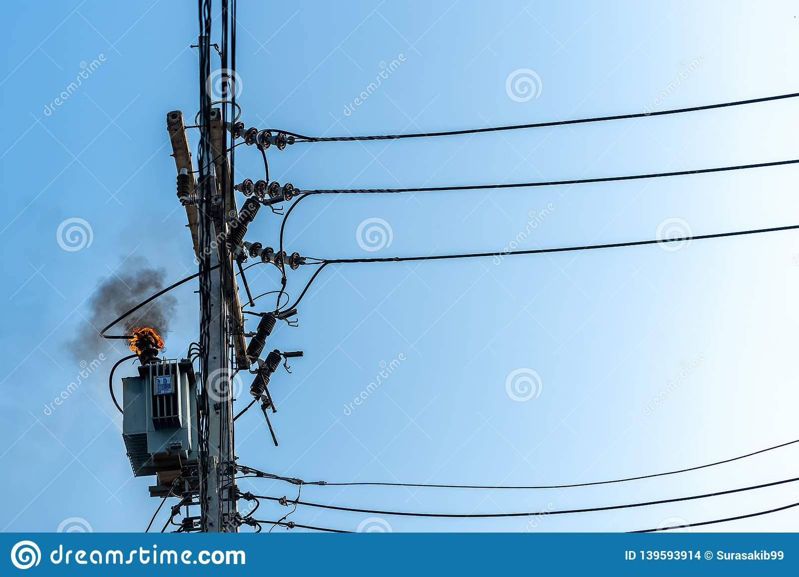 hight resolution of power pylon overload or electric short circuit at transformer on poles and fire or flame with