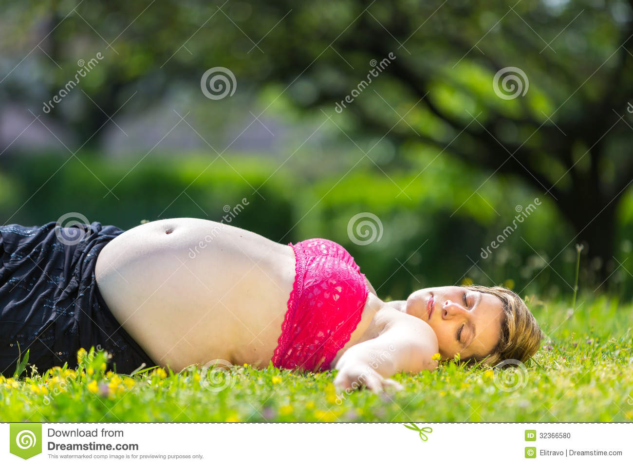 Pregnant Woman Lying In Green Grass Stock Photo  Image